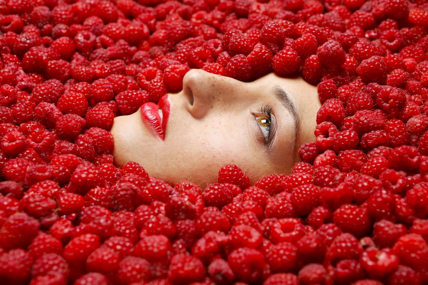 beautiful girl in raspberries