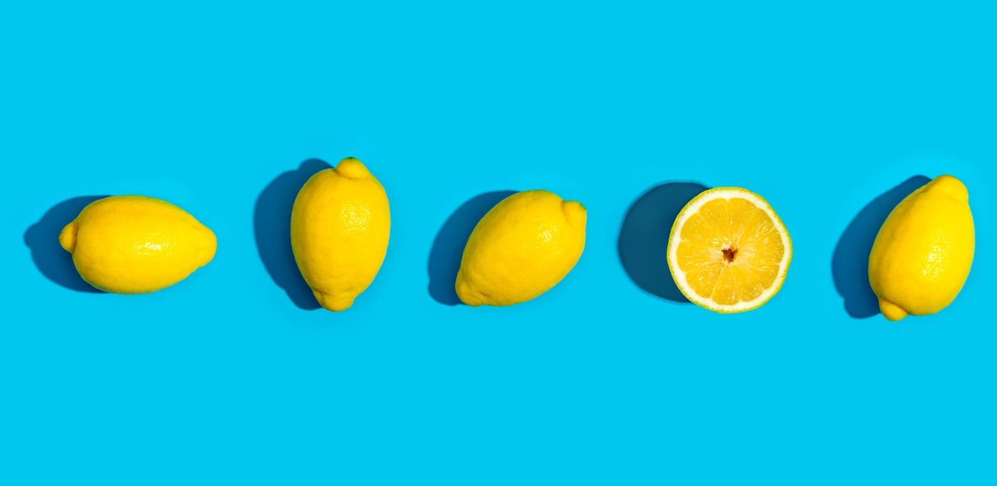 Fresh lemon pattern on a vivid blue background