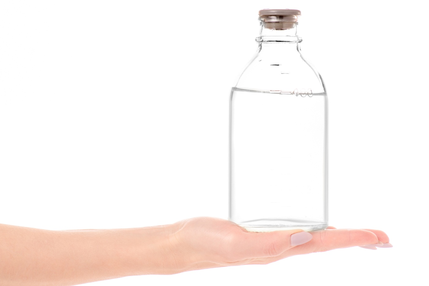 Bottle with medical alcohol disinfection in hand